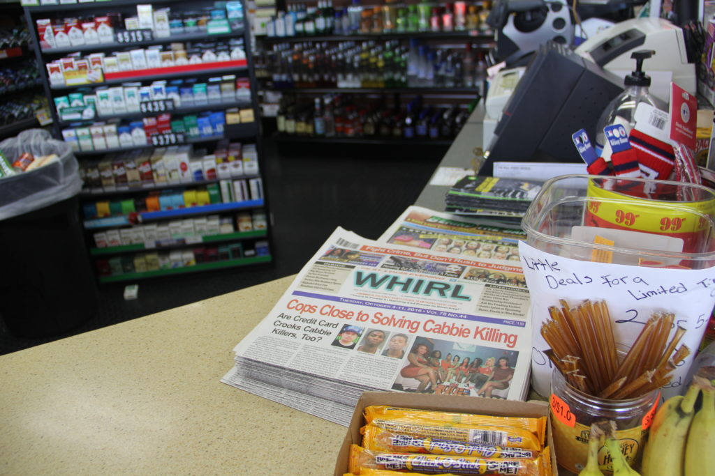 Copies of The Whirl at the gas station where it's first delivered every Monday.