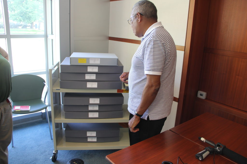 Anthony Sanders, The Whirl's current owner, looks at the paper's archive at Washington University in St. Louis.
