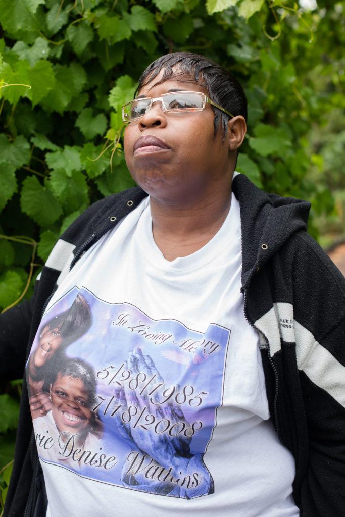 "Carrie Watkins wearing a shirt memorializing her daughter, Carrie Denise ""Nook"" Watkins."