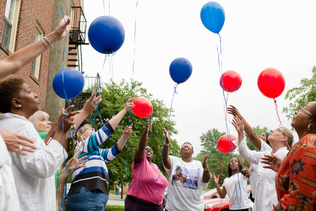 Carrie Watkins with other mothers and friends releasing red and blue balloons, on what would have been her daughter's 29th birthday.